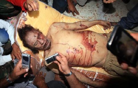 Kaddafinin ceset fotoğrafı için yarıştılar  galerisi resim 1