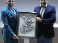 Mustafa Dişli'den Abdullah Ağralı'ya Plaket