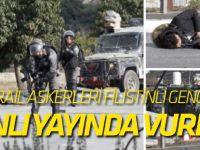 İsrail askerleri Filistinli genci canlı yayında vurdu!