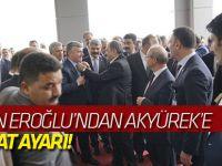 Bakan Eroğlu'ndan Akyürek'e kravat ayarı