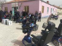 Kulu'da ihtiyaç sahiplerine engelli bisikleti dağıtıldı