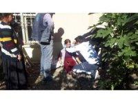 Kırılan tahta merdivenden düşen kadın yaralandı