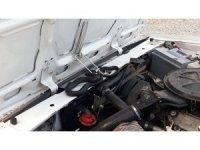 Otomobilin motor bölümüne giren yılan uzun uğraş sonucu çıkarıldı