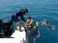 Karadeniz'den kıyıya dönmekte zorlanan çocukları polis kurtardı