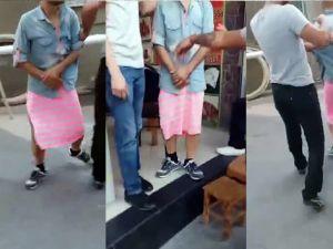 Uyuşturucu satıcısı olduğu iddia edilen kişiye etek giydirdiler